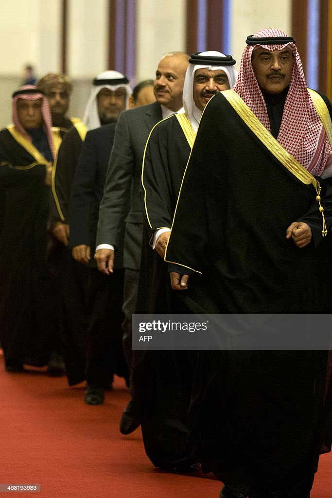 Kuwaiti Foreign Minister Sheikh Sabah Khaled al-Hamad Al-Sabah (front R) leads a group of senior officials of the Gulf Cooperation Council (GCC) before they meet Chinese President Xi Jinping at the Great Hall of the People in Beijing on January 17, 2014. The Third China-GCC Strategic Dialogue is being held in Beijing from January 17-18. AFP PHOTO / POOL / Alexander F. Yuan
