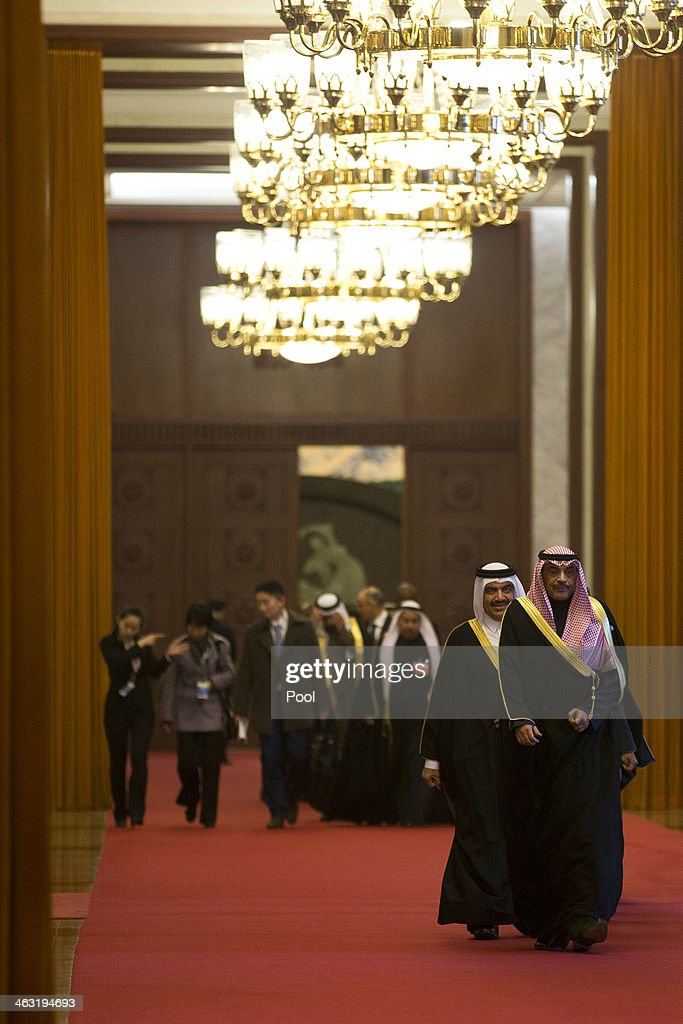 Kuwaiti Foreign Minister Sheikh Sabah Khaled al-Hamad Al-Sabah, (R), leads a group of senior officials of the Gulf Cooperation Council (GCC) on their way to meet Chinese President Xi Jinping at the Great Hall of the People January 17, 2014 in Beijing, China. The GCC is meeting to adopt united policy on water consumption, power and trade.