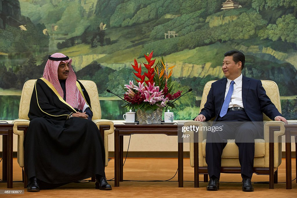 Kuwaiti Foreign Minister Sheikh Sabah Khaled al-Hamad Al-Sabah (L) talks with Chinese President Xi Jinping at the Great Hall of the People in Beijing on January 17, 2014. The Third China-GCC Strategic Dialogue is being held in Beijing from January 17-18. AFP PHOTO / POOL / Alexander F. Yuan