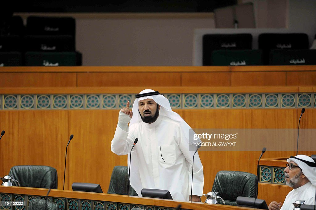 Kuwaiti Islamist MP Khaled al-Adwah speaks during a parliament session at Kuwait national assembly in Kuwait City on March 20,2013. Kuwait's parliament passed in principle a bill that requires the government to buy billions of dollars of bank loans owed by citizens and reschedule them after waiving interest.