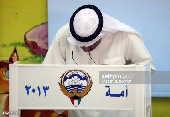 A Kuwaiti man casts his ballot at a polling station in Kuwait City on July 27 2013 Kuwaitis were called to the polls today for the Gulf emirate's...