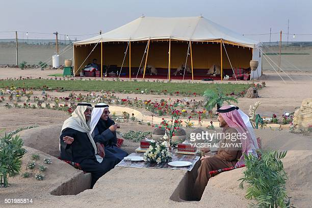 Kuwaiti men hang out at a winter camp in Kuwaits desert some 120 km Northwest of Kuwait City on December 19 2015 The official camping season in...