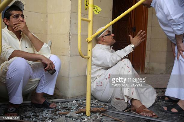 Kuwaiti men react at the site of a suicide bombing that targeted the Shiite AlImam alSadeq mosque during Friday prayers on June 26 in Kuwait City AFP...