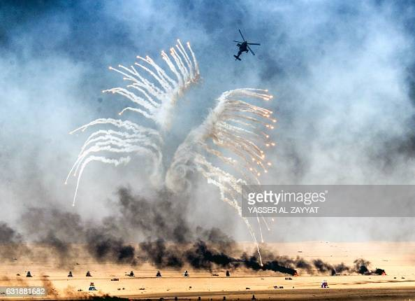 Kuwaiti military helicopter takes part in a live ammunition military exercise at Udaira military range 140 km north of Kuwait City on January 17 2017...