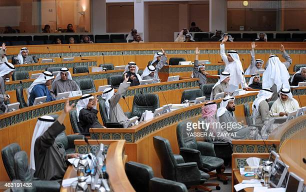 Kuwaiti MPs vote during a parliament session at Kuwait's national assembly in Kuwiat City on February 112015 during which they approved a fiveyear...