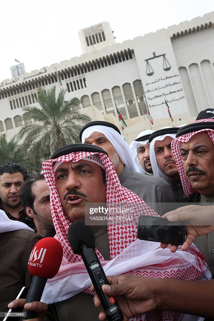 Kuwaiti opposition leader and former MP Mussallam al-Barrak (C) speaks to reporters after leaving the Palace of Justice surrounded by his supporters in Kuwait City, on January 28, 2013. Dozens of Kuwaiti activists staged an unprecedented protest outside the courtroom where Barrak was being tried on charges of insulting the emir. It was the first time ever that a protest took place inside the Palace of Justice in Kuwait. Police did not interfere in the protest which passed off peacefully.