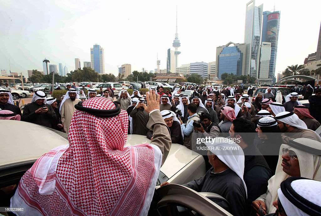 Kuwaiti opposition leader and former MP Mussallam al-Barrak (C) waves to supporters after leaving the Palace of Justice in Kuwait City, on January 28, 2013. Dozens of Kuwaiti activists staged an unprecedented protest outside the courtroom where Barrak was being tried on charges of insulting the emir. It was the first time ever that a protest took place inside the Palace of Justice in Kuwait. Police did not interfere in the protest which passed off peacefully.