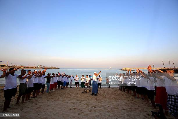 Kuwaiti pearl divers prepare for the upcoming of the Pearl Diving Festival in Kuwait City on August 132013 Pearldiving trips are held annually under...