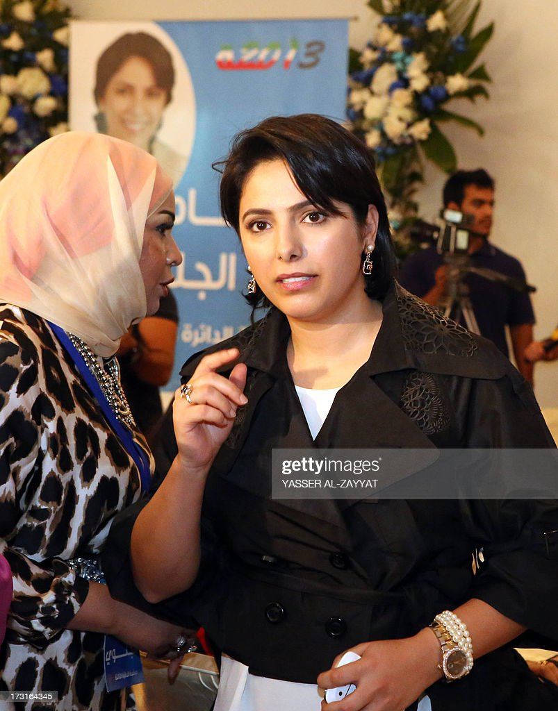Kuwaiti Reham al-Jlewe (R), a candidate in Kuwait's upcoming parliamentary elections, welcomes her guests at her election campaign tent in Kuwait City on July 8, 2013. Kuwait will hold a second parliamentary election in eight months on July 27 amid a political crisis that has stalled development in the wealthy Gulf state and a boycott by the opposition.
