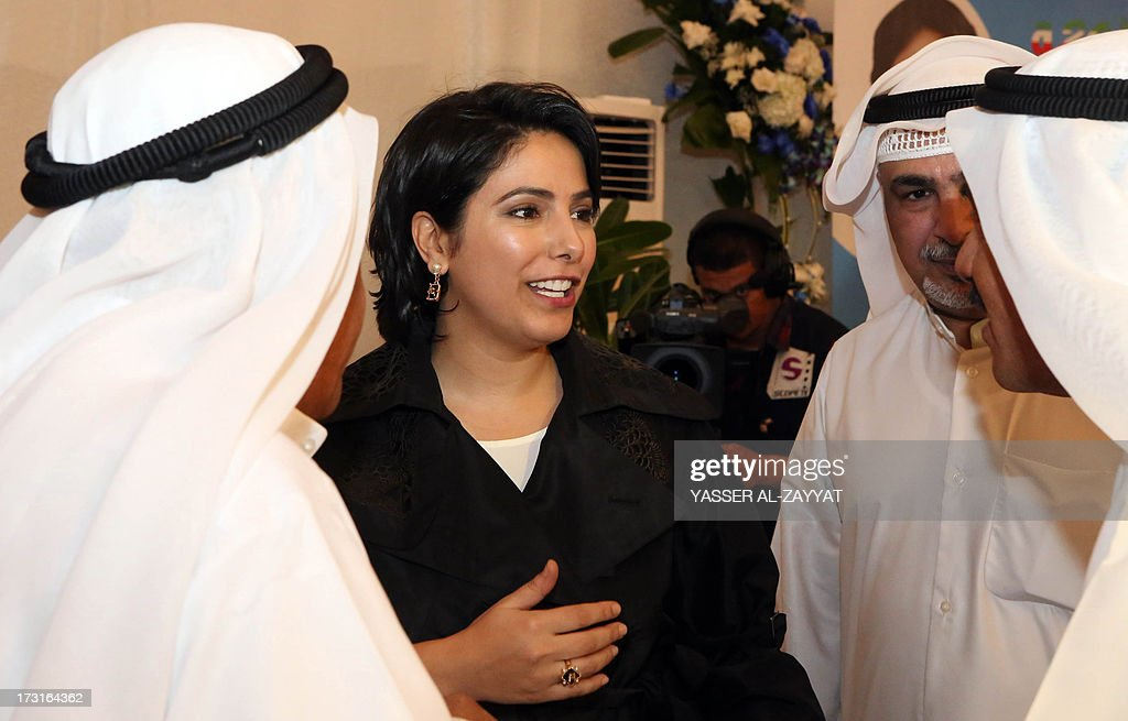 Kuwaiti Reham al-Jlewe (C), a candidate in Kuwait's upcoming parliamentary elections, welcomes her guests at her election campaign tent in Kuwait City on July 8, 2013. Kuwait will hold a second parliamentary election in eight months on July 27 amid a political crisis that has stalled development in the wealthy Gulf state and a boycott by the opposition.