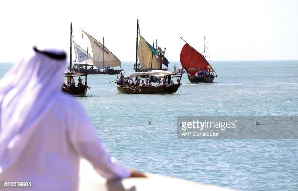 Kuwaiti sailors prepare to sail away in Dhows on a pearl diving trip on July 27 in Kuwait City Pearldiving trips are held annually under the...