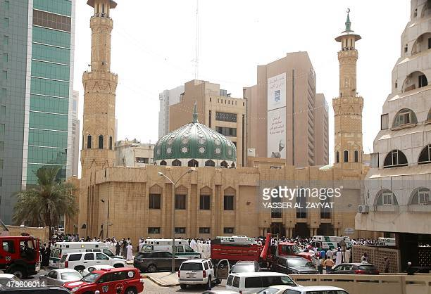 Kuwaiti security forces and emergency personnel gather outside the Shiite AlImam alSadeq mosque after it was targeted by a suicide bombing during...