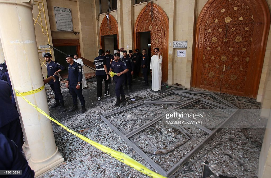 Kuwaiti security forces gather outside the Shiite AlImam alSadeq mosque after it was targeted by a suicide bombing during Friday prayers on June 26...