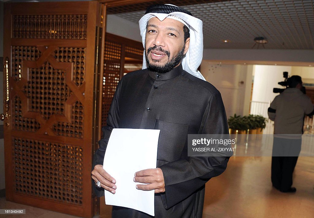 Kuwaiti Shiite lawmaker Faisal al-Duwaisan gestures to the press on February 10, 2013, after filing a request to grill Kuwaiti Interior Minister Sheikh Ahmad al-Homud al-Saba, a senior member of the ruling family, at the Kuwait's National Assembly in Kuwait City. Duwaisan filed to question in parliament the interior minister over allegations that his ministry was dealing with Israel and for failing to control opposition-led protests. AFP PHOTO/YASSER AL-ZAYYAT