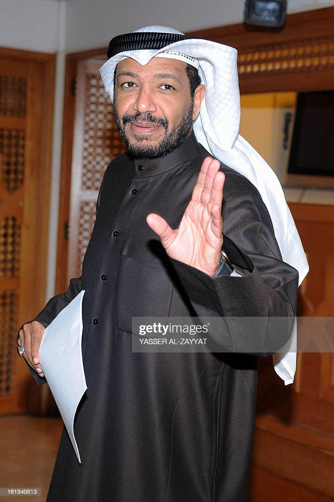 Kuwaiti Shiite lawmaker Faisal al-Duwaisan gestures to the press on February 10, 2013, after filing a request to grill Kuwaiti Interior Minister Sheikh Ahmad al-Homud al-Saba, a senior member of the ruling family, at the Kuwait's National Assembly in Kuwait City. Duwaisan filed to question in parliament the interior minister over allegations that his ministry was dealing with Israel and for failing to control opposition-led protests.