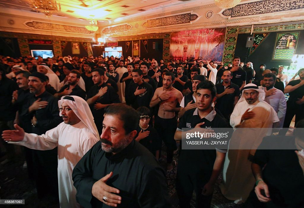 Kuwaiti Shiite Muslim take part in a traditional mourning event during Ashura commemorations that mark the killing of Imam Hussein one of Shiite...