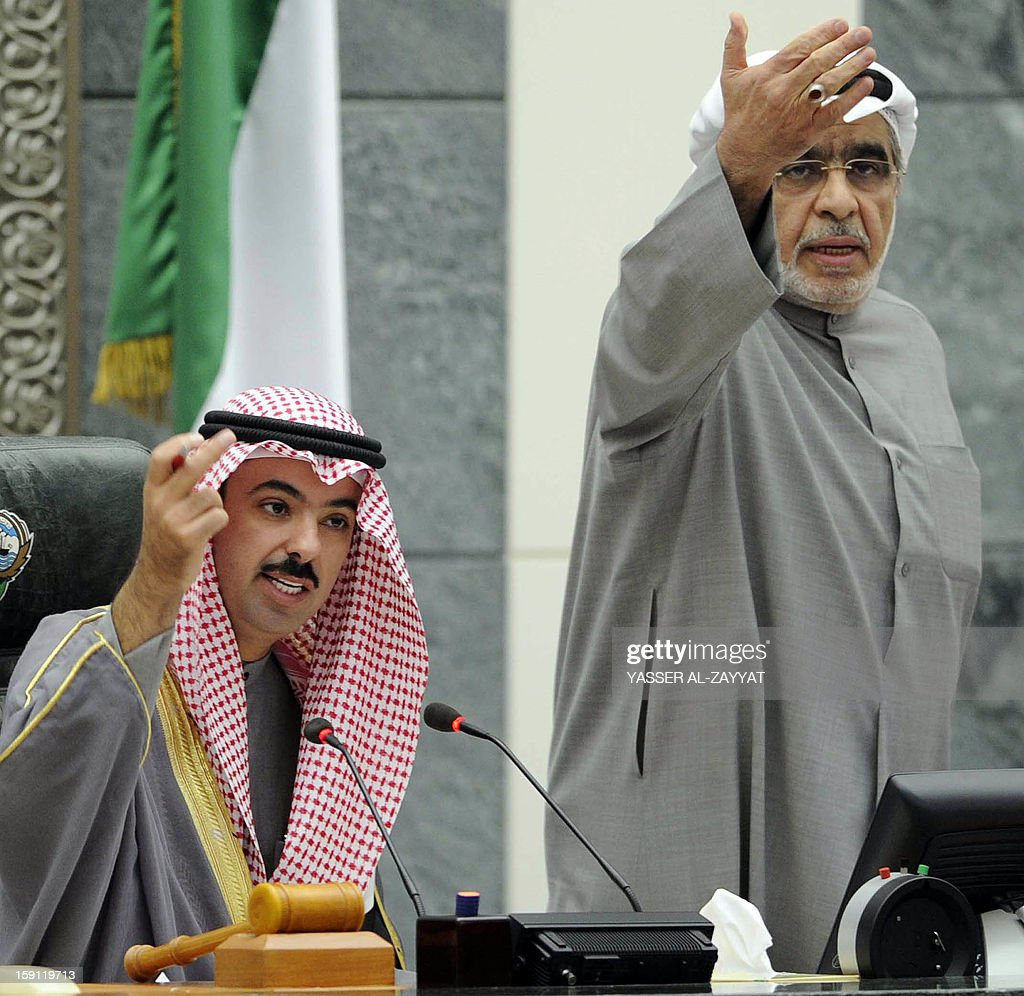 Kuwaiti speaker Ali al-Rashed (L) and Kuwaiti Shiite Muslim MP Adnan AbdulSamad reacting during a parliament session at Kuwait National Assembly in Kuwait City on January 8, 2013. Kuwait parliament overwhelmingly approved the controversial electoral decree that caused the opposition in the oil-rich Gulf state to boycott the December 1 general elections. AFP PHOTO/YASSER AL-ZAYYAT