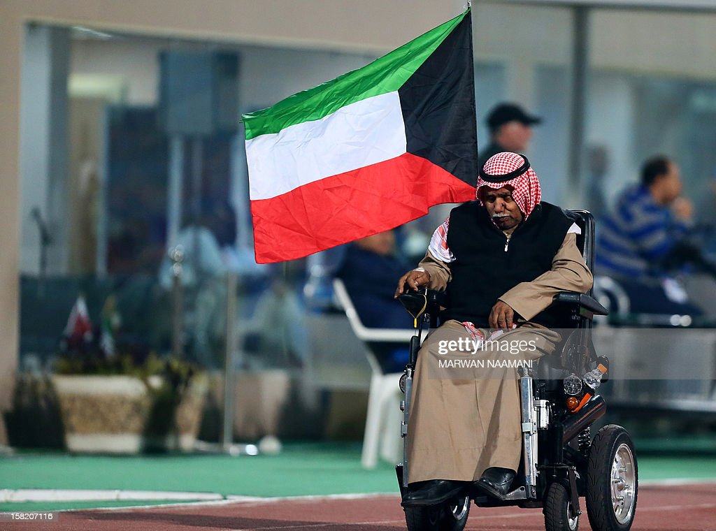A Kuwaiti supporter leaves the stadium few minutes before the game between Kuwait and Oman ended in the 7th West Asian Football Federation (WAFF) championship in Kuwait City on December 11, 2012.