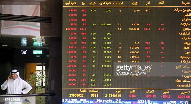 A Kuwaiti trader follows the stock market activity at the Kuwait Stock Exchange in Kuwait City on March 26 2015 The oil price surge after Saudi jets...