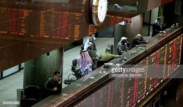 Kuwaiti traders follow the stock market activity at the Kuwait Stock Exchange in Kuwait City on January 17 2015 Share prices in the energyrich Gulf...
