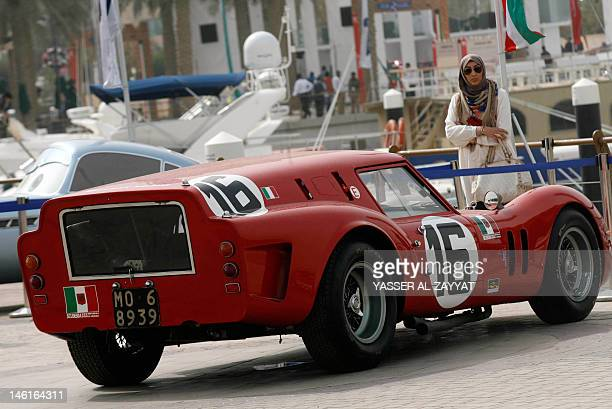 A Kuwaiti woman looks at 1962 Ferrari 250GT Breadvan displayed at the Historical Vintage and Classic Cars exhibition at Marina Crescent in Salmeyya...