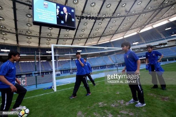 Kuwaiti youth practice under a message welcoming FIFA president Gianni Infantino during a tour of the Sheikh Jaber AlAhmad International Stadium in...