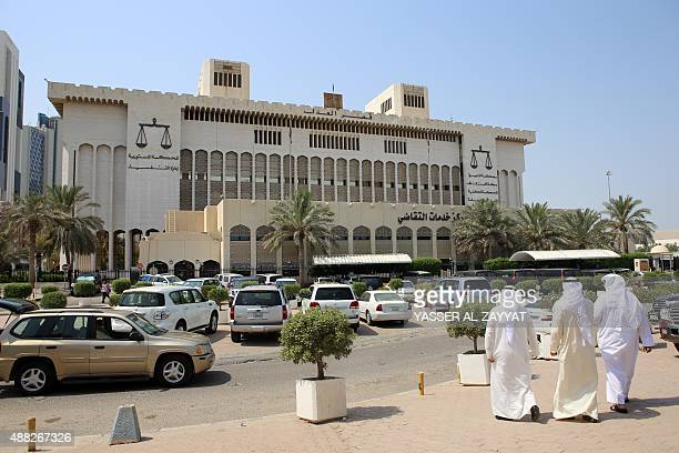 Kuwaitis arrive at the Palace of Justice where the sentence hearing of 29 defendants for their roles in a deadly Shiite mosque bombing claimed by the...