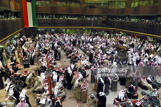 Kuwaitis crowd the hall of the Kuwait Stock Exchange the second largest in the Arab world on a busy day of dealings 06 January 2004 The KSE index...