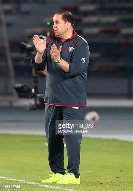 Kuwait's coach Nabil Maaloul gestures to his team from the sidelines during their friendly football match against Colombia at the Sheikh Zayed...