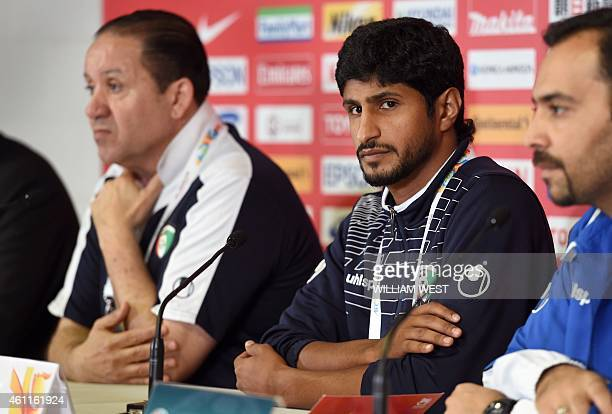 Kuwait's football captain Mesaed Al Enzi and coach Nabil Maaloul listen to questions before their final training session ahead of the Asian Cup in...