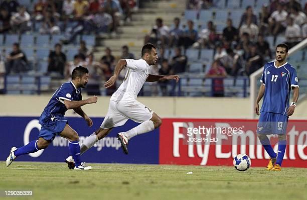 Kuwait's Midfielder Abdulaziz Mashan AlEnezi fights for the ball with Lebanon's Midlfielder Roda Antar during their 2014 World Cup Asian zone...