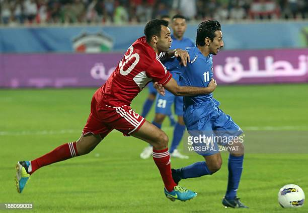 Kuwait's Said AlHashan is defended by Lebanon's Roda Antar during their AFC Asian cup match in Kuwait city on November 15 2013 AFP PHOTO/YASSER...