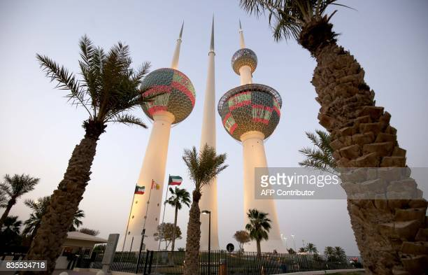 Kuwait's Towers in Kuwait City are illuminated in the colours of the Spanish flag on August 19 in tribute to the victims of the August 17 attack in...