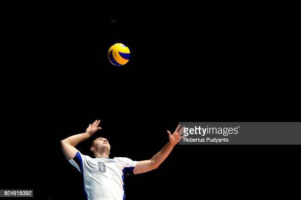 Kuznetsov Sergey of Kazakhstan serves during the 19th Asian Senior Men's Volleyball Championship semifinal match between Korea and Kazakhstan at GOR...