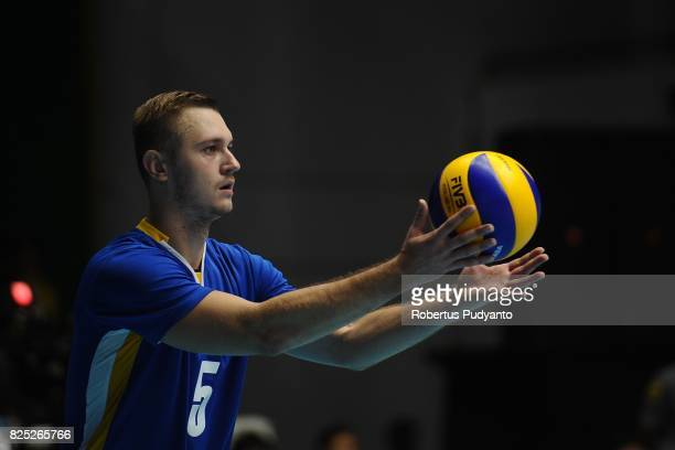 Kuznetsov Sergey of Kazakhstan serves during the 19th Asian Senior Men's Volleyball Championship final match between Japan and Kazakhstan at GOR...