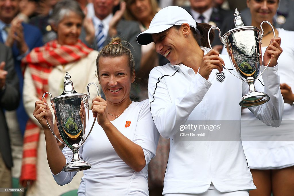 Kveta Peschke of the Czech Republic (L) and Katarina Srebotnik of Slovenia hold up their championship trophies after winning their final round Ladies' doubles match against Sabine Lisicki of Germany and Samantha Stosur of Australia on Day Twelve of the Wimbledon Lawn Tennis Championships at the All England Lawn Tennis and Croquet Club on July 2, 2011 in London, England.