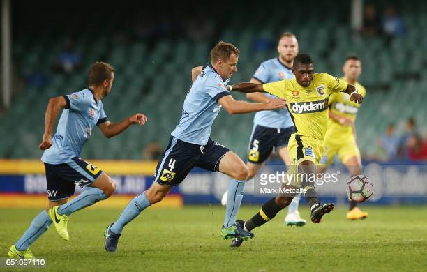 Kwabena Appiah of the Mariners runs at Alex Wilkinson of Sydney FC during the round 23 ALeague match between Sydney FC and the Central Coast Mariners...