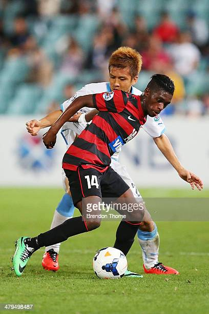 Kwabena Appiah of the Wanderers competes with Junichi Inamoto of Kawasaki Frontale during the AFC Asian Champions League match between the Western...