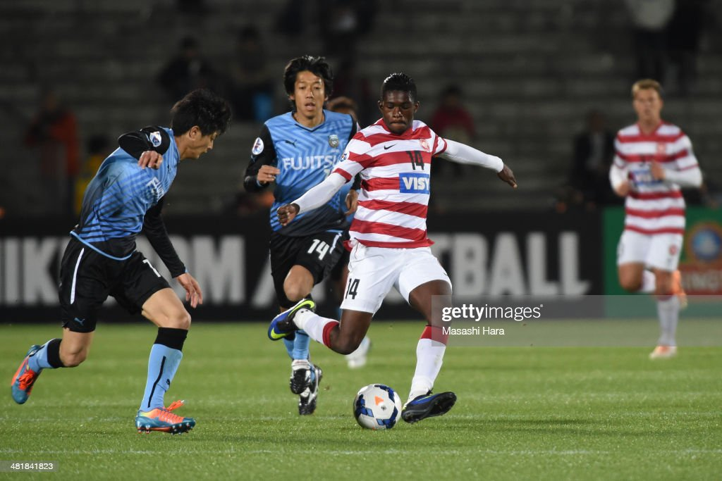 Kwabena Appiah #14 of Western Sydney Wanderers in action the AFC Champions League Group H match between Kawasaki Frontale and Western Sydney Wanderers at Todoroki Stadium on April 1, 2014 in Kawasaki, Japan.