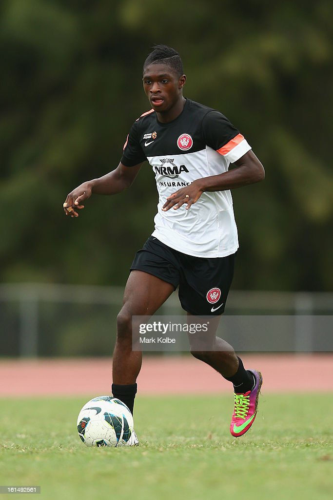 Kwabena Appiah-Kubi runs the ball during a Western Sydney Wanderers A-League training session at Blacktown International Sportspark on February 12, 2013 in Sydney, Australia.