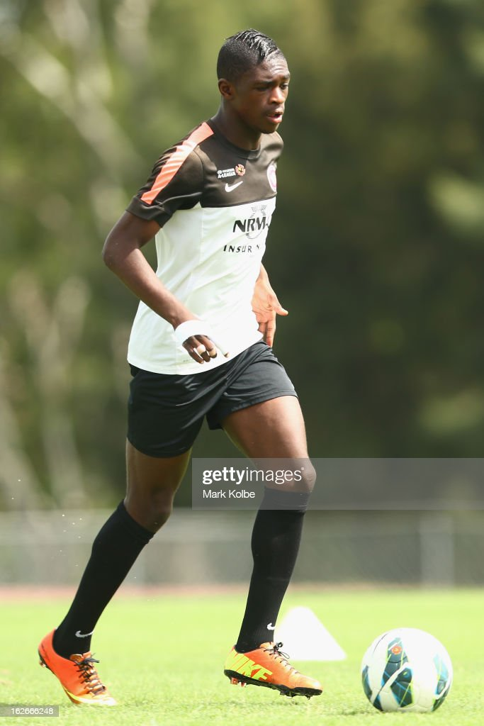 Kwabena Appiah-Kubi runs the ball during a Western Sydney Wanderers A-League training session at Blacktown International Sportspark on February 26, 2013 in Sydney, Australia.
