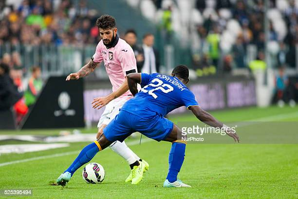 Kwadwo Asamoah and Eros Pisano during the Serie A match betweenJuventus FC and US Palermo at Juventus Stafium on october 26 2014 in Torino Italy