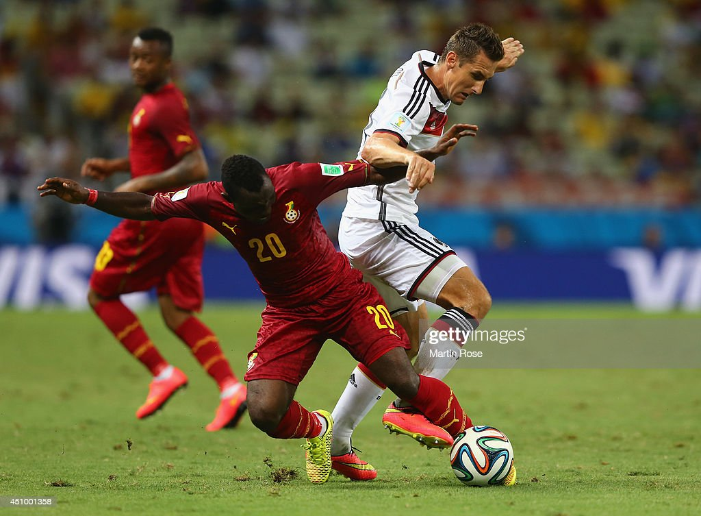 <a gi-track='captionPersonalityLinkClicked' href=/galleries/search?phrase=Kwadwo+Asamoah&family=editorial&specificpeople=4376914 ng-click='$event.stopPropagation()'>Kwadwo Asamoah</a> of Ghana and <a gi-track='captionPersonalityLinkClicked' href=/galleries/search?phrase=Miroslav+Klose&family=editorial&specificpeople=206489 ng-click='$event.stopPropagation()'>Miroslav Klose</a> of Germany compete for the ball during the 2014 FIFA World Cup Brazil Group G match between Germany and Ghana at Castelao on June 21, 2014 in Fortaleza, Brazil.