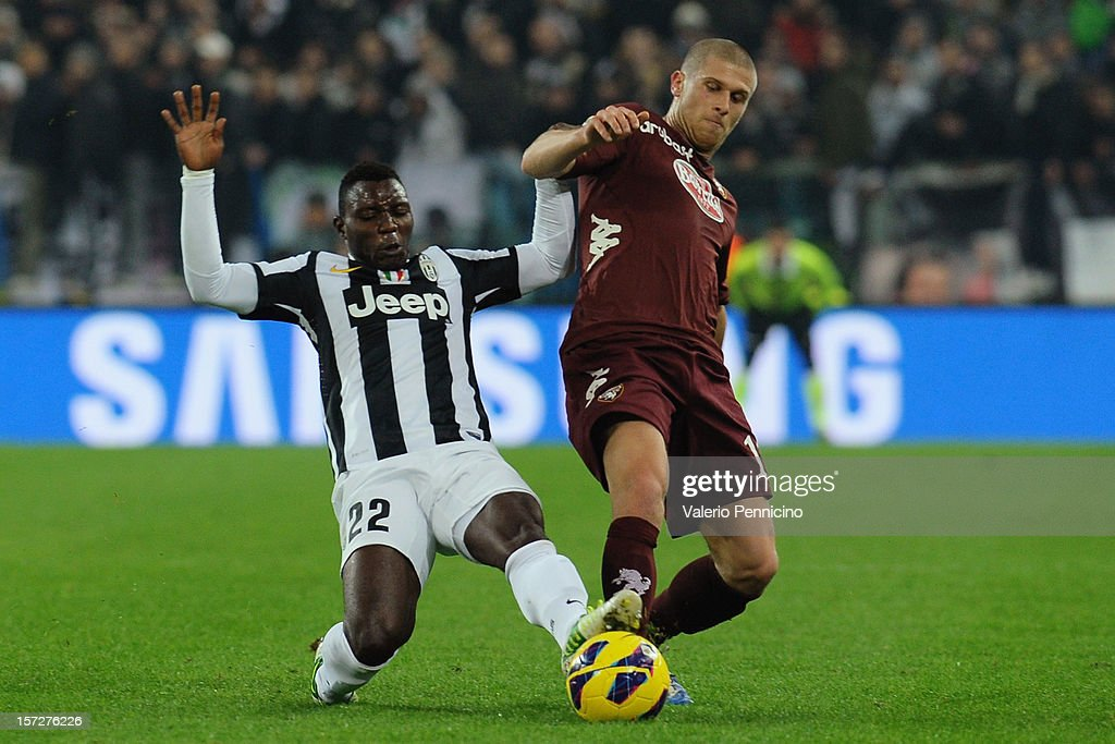 <a gi-track='captionPersonalityLinkClicked' href=/galleries/search?phrase=Kwadwo+Asamoah&family=editorial&specificpeople=4376914 ng-click='$event.stopPropagation()'>Kwadwo Asamoah</a> (L) of Juventus competes with Alen Stevanovic of Torino FC during the Serie A match between Juventus and Torino FC at Juventus Arena on December 1, 2012 in Turin, Italy.