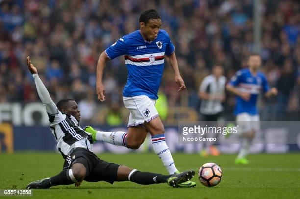 Kwadwo Asamoah of Juventus FC and and Luis Muriel of UC Sampdoria compete for the ball during the Serie A football match between UC Sampdoria and...