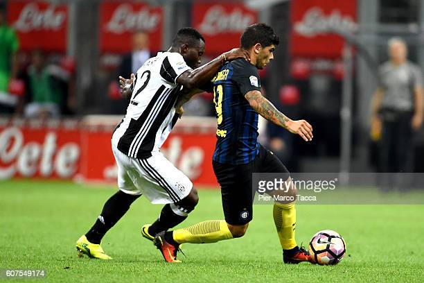 Kwadwo Asamoah of Juventus FC competes for the ball with Ever Banega of FC Internazionale during the Serie A match between FC Internazionale and...