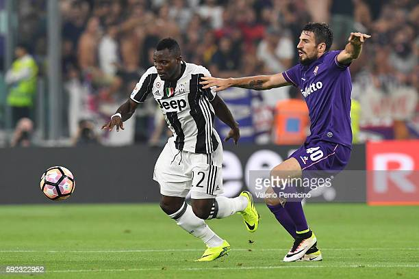 Kwadwo Asamoah of Juventus FC is challenged by Nenad Tomovic of ACF Fiorentina during the Serie A match between Juventus FC and ACF Fiorentina at...
