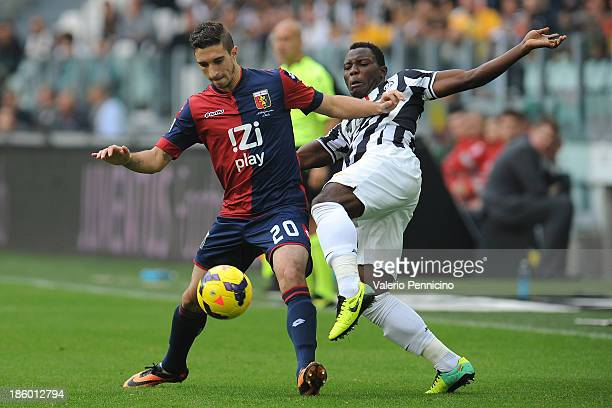 Kwadwo Asamoah of Juventus is challenged by Sime Vrsaljko of Genoa CFC during the Serie A match between Juventus and Genoa CFC at Juventus Arena on...