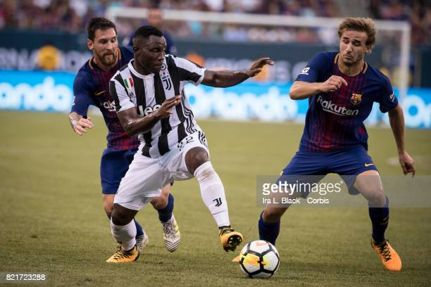 Kwadwo Asamoah of Juventus tries to keep control against Lionel Messi of Barcelona and Sergi Samper of Barcelona during the International Champions...