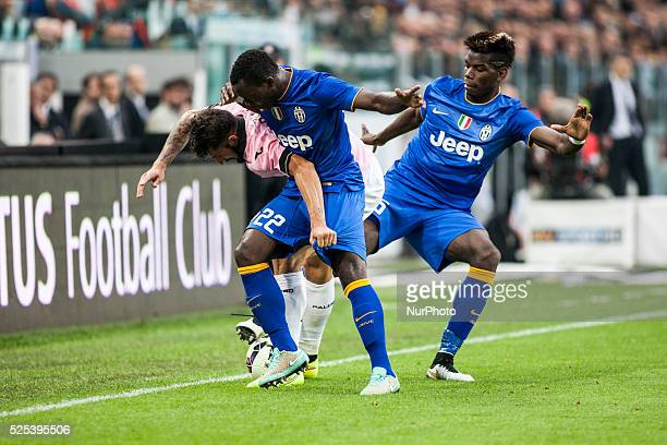 Kwadwo Asamoah Paul Pogba and Eros Pisano during the Serie A match betweenJuventus FC and US Palermo at Juventus Stafium on october 26 2014 in Torino...